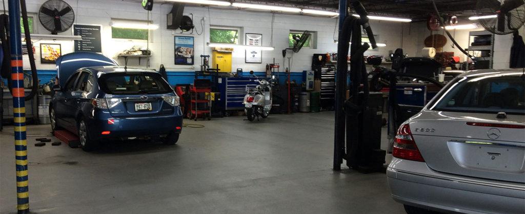 Image: Mercedes, Subaru, Vespa in shop