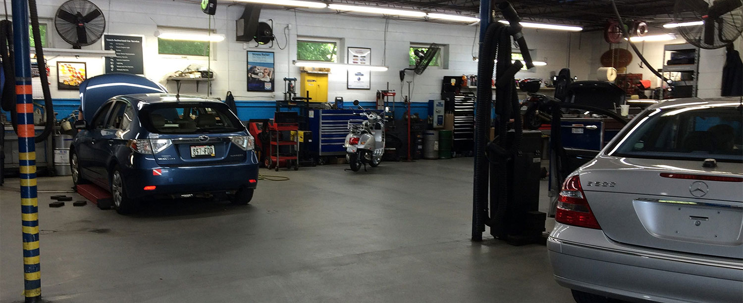 Image: Mercedes, Subaru, Vespa in shop